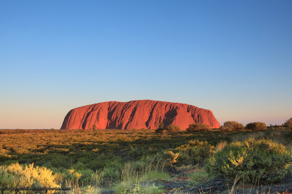 ayers rock at sunset in australia