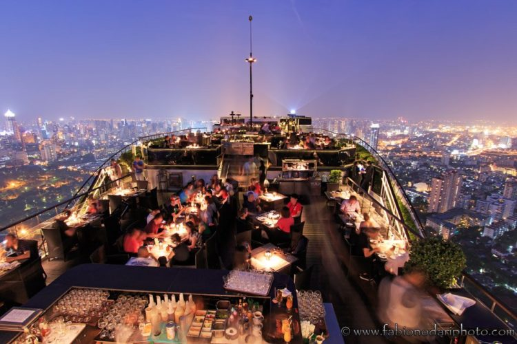 bangkok by night as seen from a rooftop bar