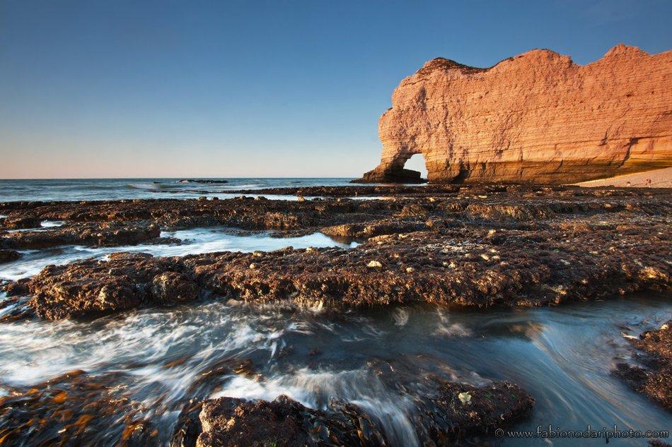 cliff of etretat at sunset