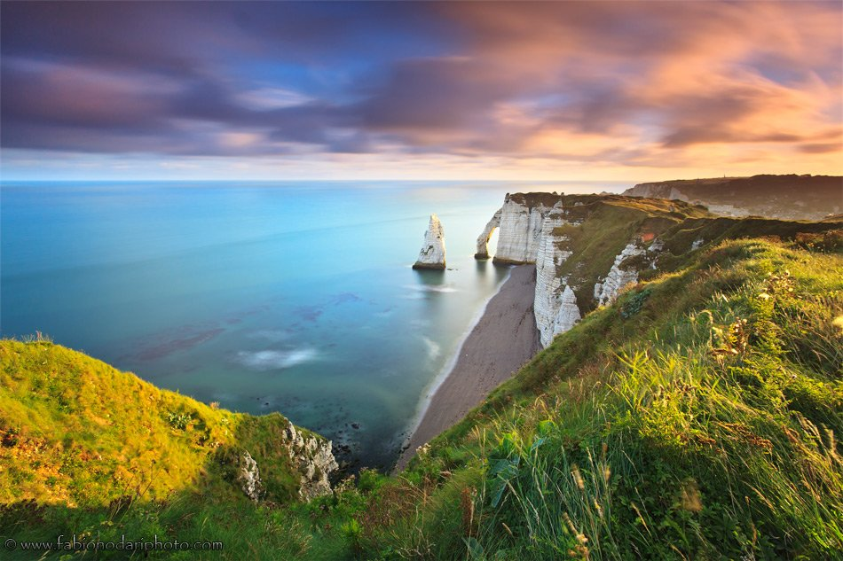 sunrise over the cliff of etretat in normandy france
