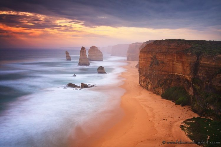 sunset over the twelve apostles of the great ocean road in australia