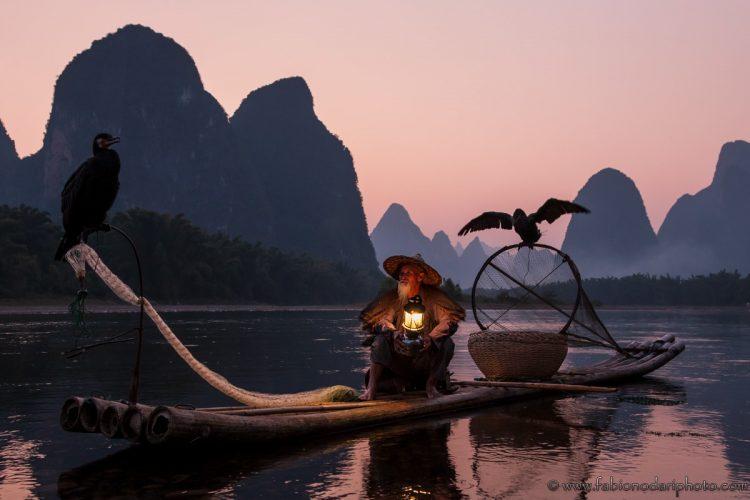 pescatore con i cormorani